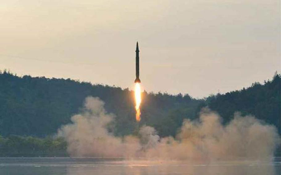 North Korea fires a missile shown in photos published May 30, 2017, in Rodong Sinmun, the official organ of the ruling Workers' Party. The photos did not include a caption but accompanied a story about a launch of a short-range missile that reportedly occurred the day before.