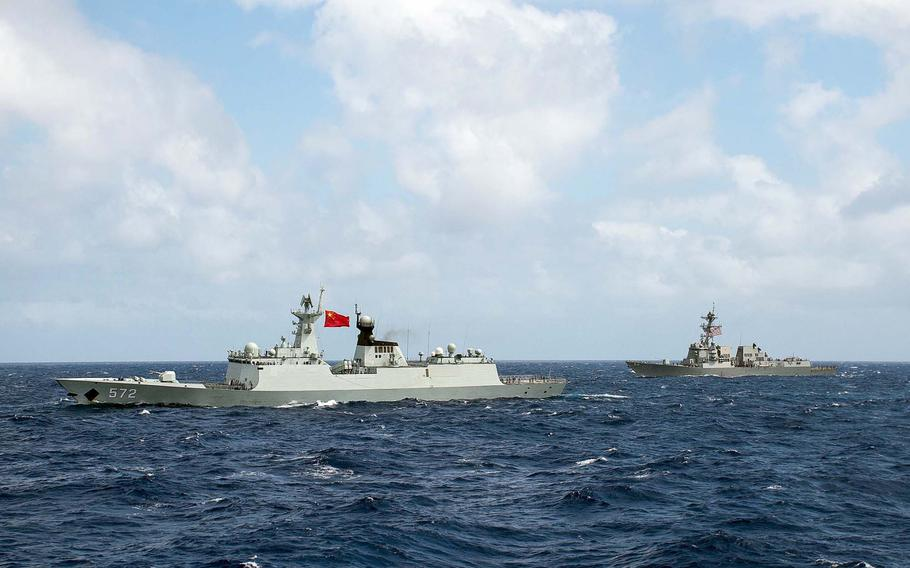 The Chinese frigate Hengshui and the guided-missile destroyer USS Stockdale transit in formation during Rim of the Pacific 2016. China has been invited back for RIMPAC 2018, despite recent incidents with U.S. ships and aircraft.  Ryan J. Batchelder/U.S. Navy