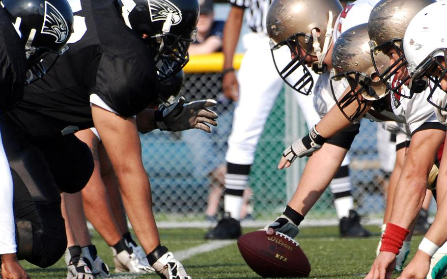 Players line up for a play during a U.S. Forces Japan-American Football league game in Yokosuka, Japan, in June 2009.
