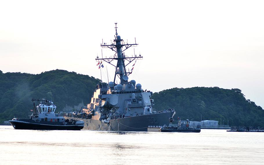 The destroyer USS Fitzgerald returns to Fleet Activities Yokosuka on June 17, 2017 following a collision with a merchant vessel