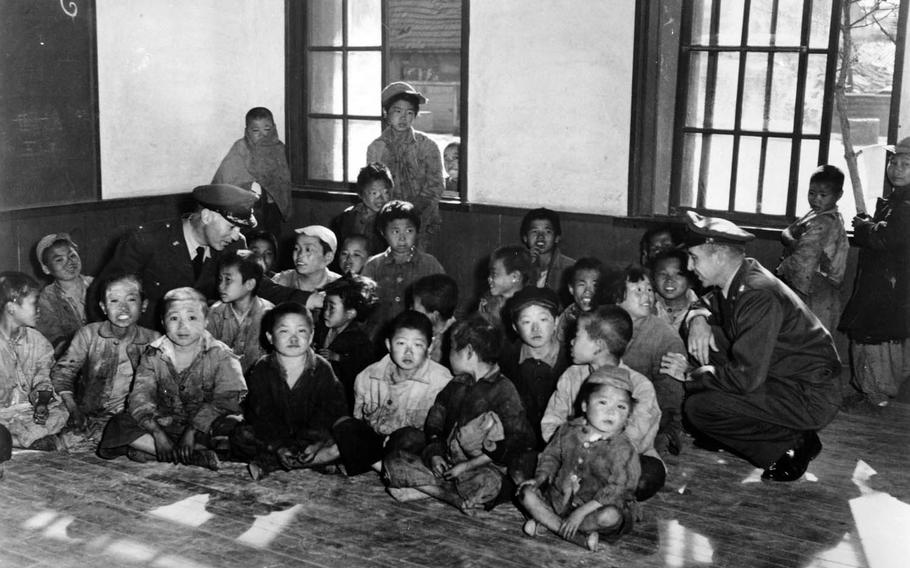New arrivals at the 5th Air Force's Seoul processing center for orphans, before evacuation to Jeju Island on Dec. 20, 1950. With them are Chaplain Col. Wallace Wolverton, left, and Chaplain Lt. Col. Russell Blaisdell.