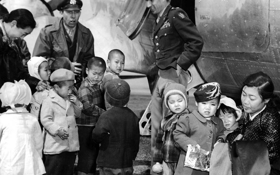 Chaplain Lt. Col. Russell Blaisdell, left, and Lt. Col. Dean Hess, right, visit Jeju Island after saving nearly 1,000 Korean orphans in late 1950. The children were well fed and clothed.