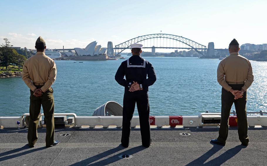 Sailors and Marines man the rails as the amphibious assault ship USS Bonhomme Richard pulls into the Sydney Harbor, Thursday, June 29, 2017.