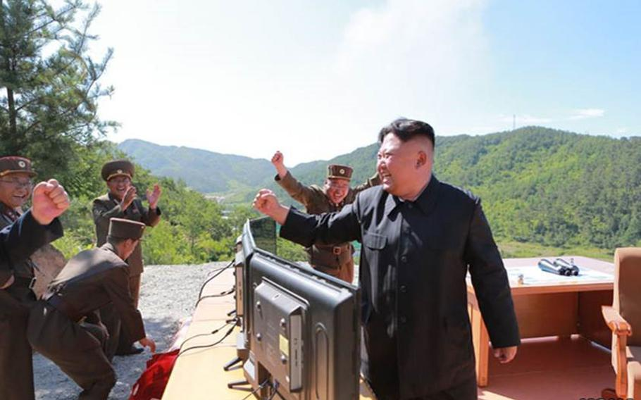 Photos published by the state-run Korean Central News Agency purportedly show North Korean leader Kim Jong Un, officers and soldiers celebrating after what the communist state claims was its first successful test of an intercontinental ballistic missile on Tuesday, July 4, 2017.