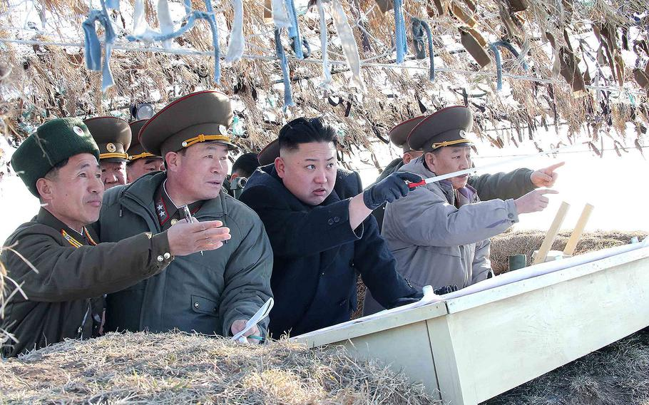 North Korea leader Kim Jong Un visits the Wolnae-do Defence Detachment on the western front line in this photo released by KCNA news agency on March 12, 2013.