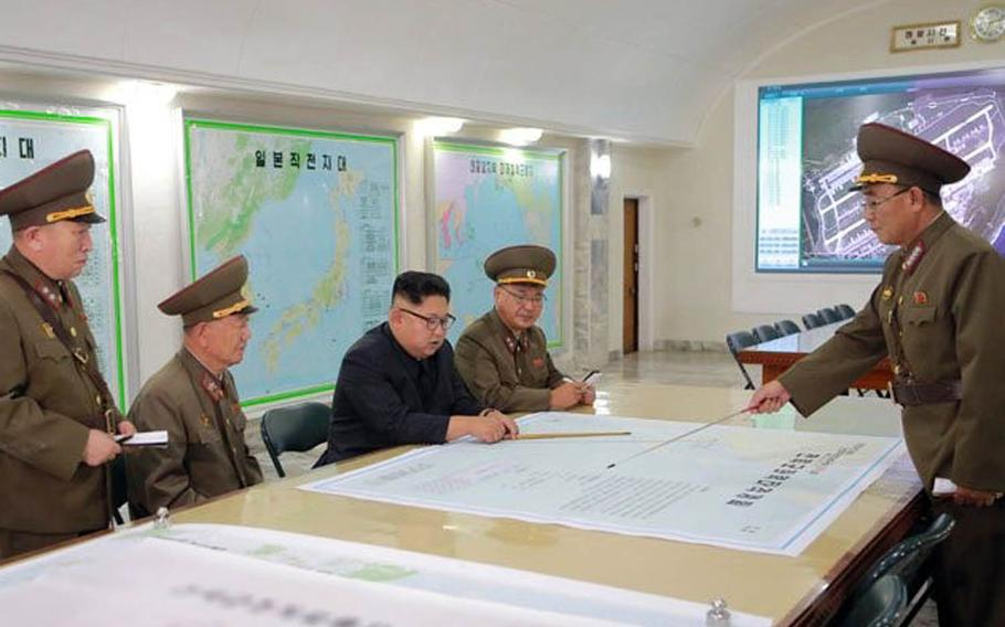"""The Korean Central News Agency reported Tuesday, Aug. 15, 2017, that the North Korean army has finalized a blueprint to """"envelop"""" the U.S. territory of Guam with fire and presented it to Kim Jong Un as he inspected his Strategic Force command the day before."""