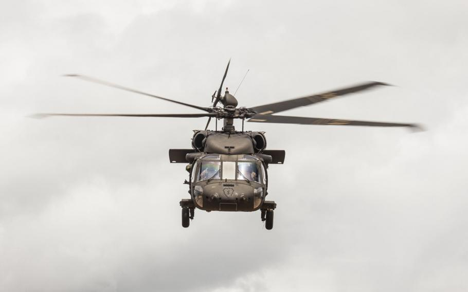 A UH-60 Black Hawk helicopter assigned to the 25th Combat Aviation Brigade lifts off aboard Marine Corps Base Hawaii on June 14, 2017.