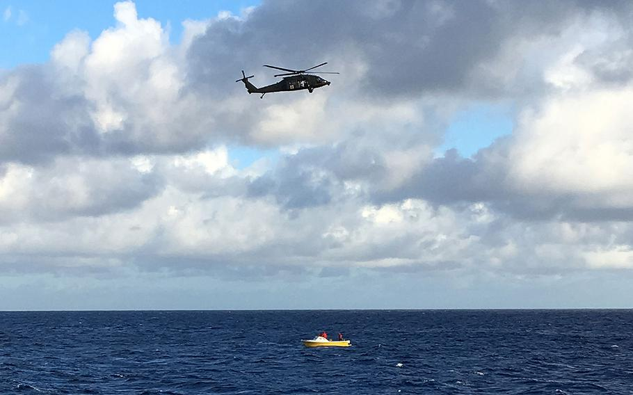 A UH-60 Black Hawk helicopter aircrew from Wheeler Army Airfield and a fireboat crew from the Honolulu Fire Department are shown conducting a search for five crewmembers aboard a downed Army UH-60 Black Hawk helicopter off Oahu on Wednesday, Aug. 16, 2017.