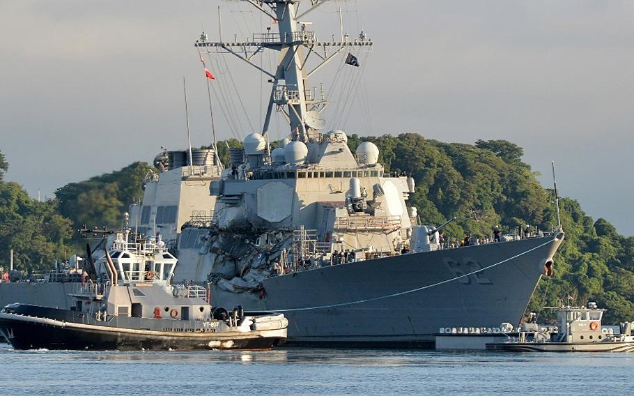 The Arleigh Burke-class guided-missile destroyer USS Fitzgerald (DDG 62) moves to Dry Dock 4 on July 11, 2017, at Fleet Activities Yokosuka to continue repairs and assess damage sustained from its June 17 collision with a merchant vessel.