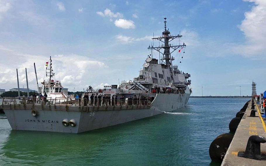 Guided-missile destroyer USS John S. McCain arrives at Changi Naval Base, Singapore, after a collision with a merchant vessel while underway east of the Strait of Malacca, Monday, Aug. 21, 2017.