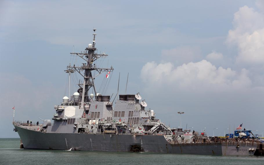 USS John S. McCain (DDG 56) moored pier side at Changi Naval Base, Republic of Singapore, following a collision with the merchant vessel Alnic MC while underway east of the Straits of Malacca and Singapore on Aug. 21.