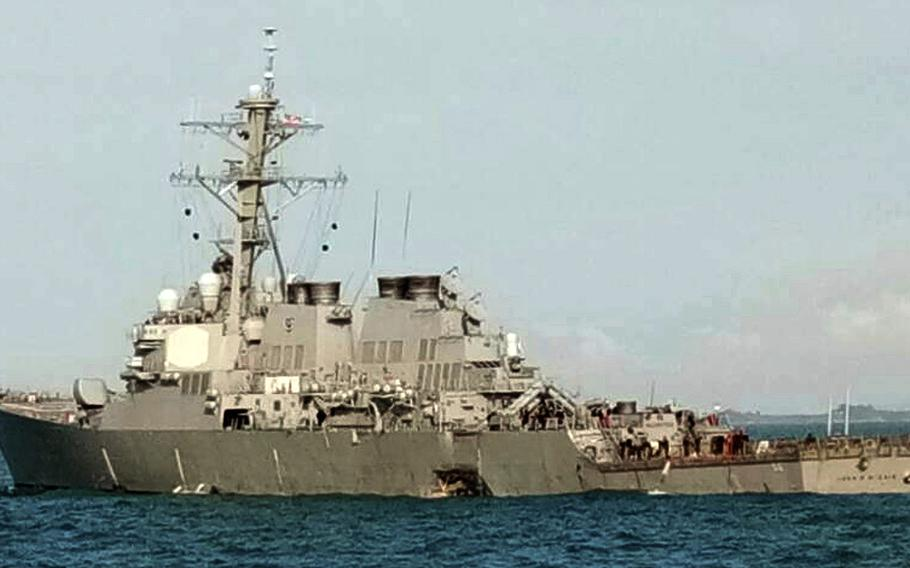 In this photo released by the Royal Malaysian Navy,  the damaged U.S guided-missile destroyer USS John S. McCain is seen off Johor, Malaysia, Monday, Aug. 21, 2017.