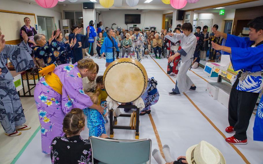 Marine Corps Air Station Iwakuni residents perform the Bon Odori alongside Japanese locals during the Bon Odori festival at Kinjuen nursing home in Iwakuni, Japan, August 14, 2017, as part of a Cultural Adaptation trip.