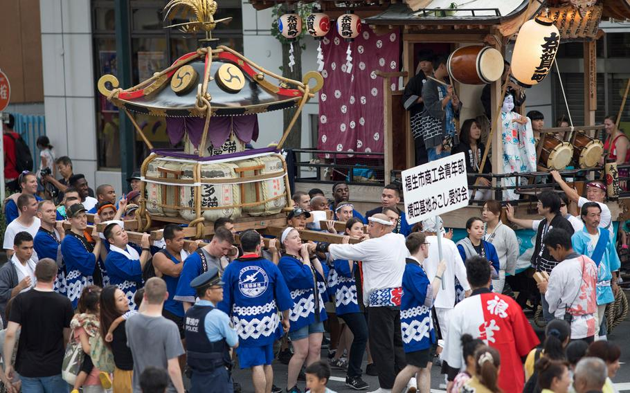 Members from Yokota Air Base carry the wing mikoshi, or a portable shrine, during the 67th Annual Fussa Tanabata Featival at Fussa City, Japan, Aug. 4, 2017.