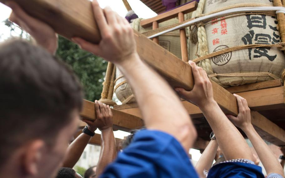 Members from Yokota Air Base carry the wing mikoshi, or a portable shrine, during the 67th Annual Fussa Tanabata Festival at Fussa City, Japan, Aug. 4, 2017. More than 80 volunteers from Yokota carried the shrine during this year's festival; Yokota Airmen have attended the festival since 1958 and have actively participated in carrying a mikoshi since 1975.