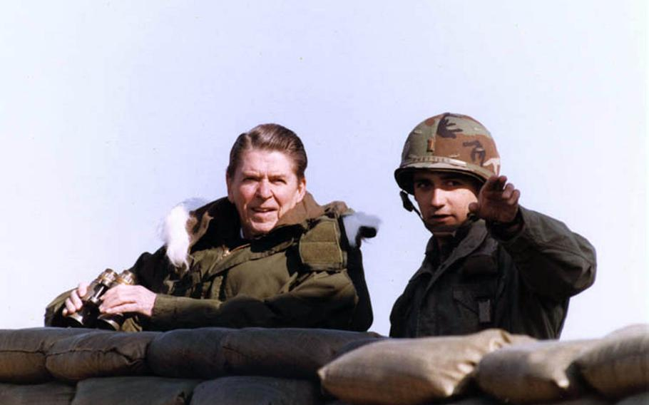 President Ronald Reagan looks out at North Korea during a visit to the Korean Demilitarized Zone on Nov. 13,1983.