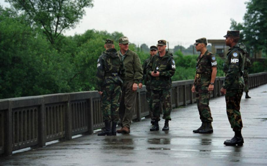 President Bill Clinton talks to soldiers on the Bridge of No Return during a visit to the Korean Demilitarized Zone on July 11,1993.