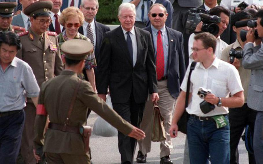 Former President Jimmy Carter crosses through the Joint Security Area of the Demilitarized Zone en route to visit then-North Korean leader Kim Il Sung to defuse a crisis in June 1994.