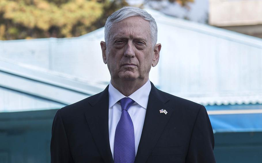 Secretary of Defense Jim Mattis stands in front of an armistice building inside the Joint Security Area at Panmunjom, South Korea, Friday, Oct. 27, 2017.
