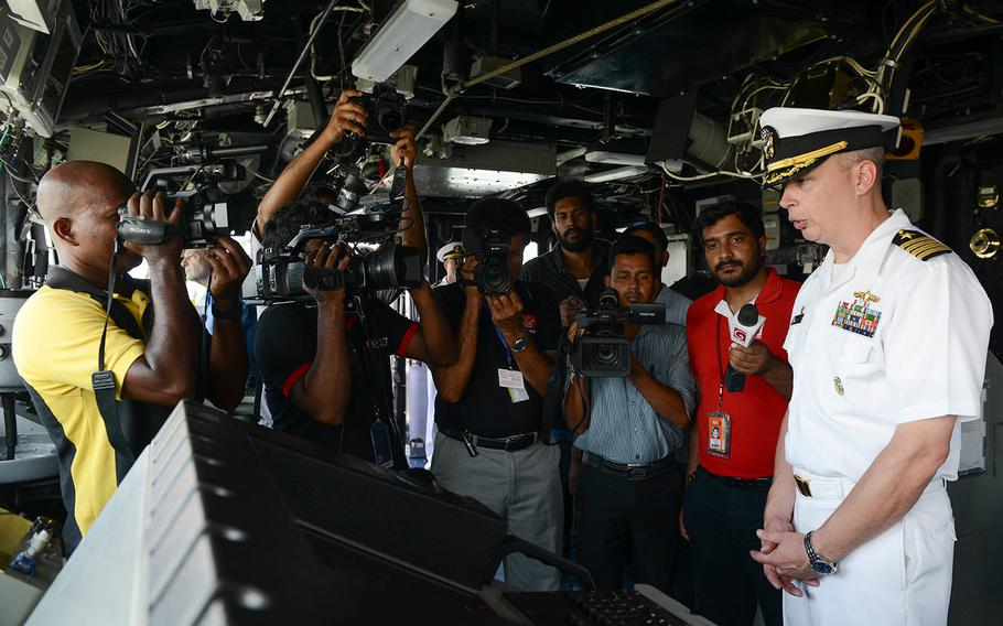 U.S. Navy Capt. Justin A. Kubu, commanding officer of the USS Princeton, gives a tour of the bridge to Sri Lankan media during a regularly scheduled port visit in Colombo, Sri Lanka on Oct. 28, 2017.