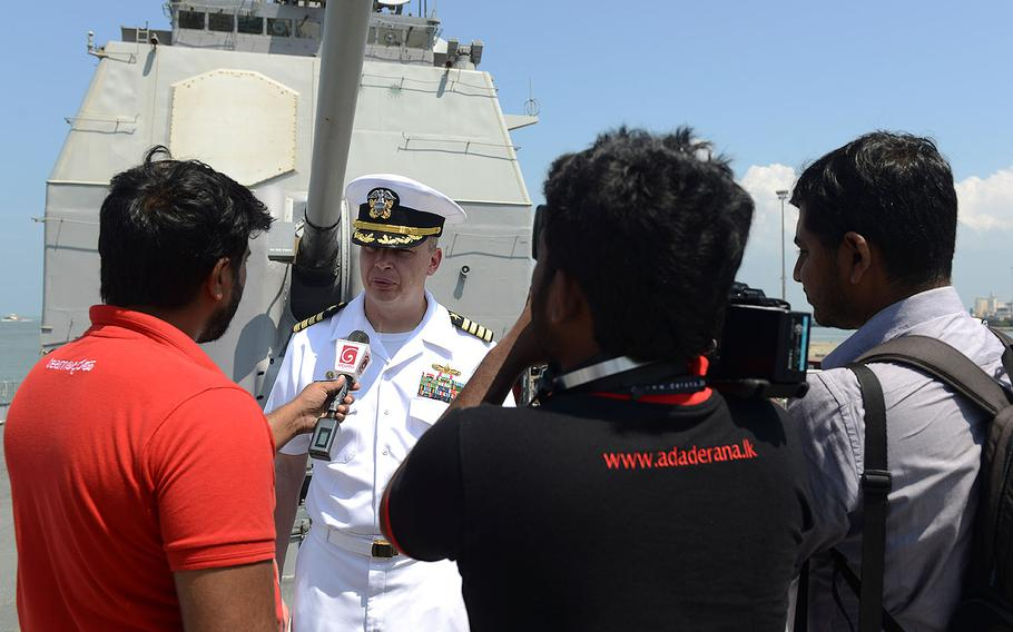Capt. Justin A. Kubu, commanding officer of the USS Princeton, is interviewed by Sri Lankan news media during a regularly scheduled port visit in Colombo, Sri Lanka on Saturday, Oct. 28, 2017.