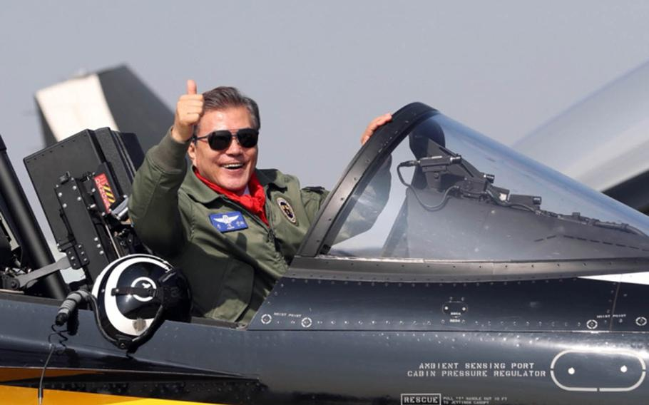 South Korean President Moon Jae-in poses in a T-50 trainer jet, Oct. 17, 2017, the opening day of the Seoul International Aerospace and Defense Exhibition.