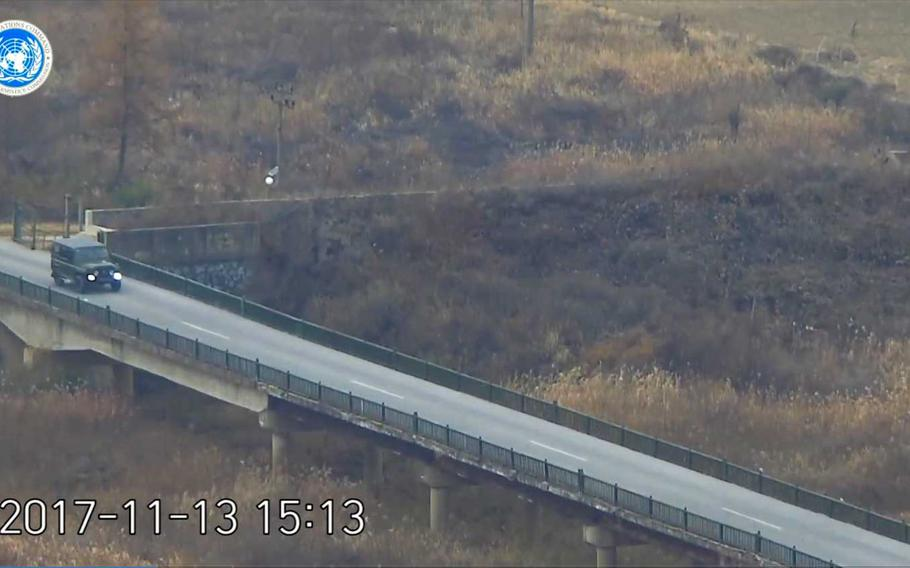 A North Korean defector, presumed to be a soldier, is seen in this still image from a video released by the UNC, driving a military jeep to the line that divides the peninsula, to later rush across it under a hail of gunfire from his former comrades.