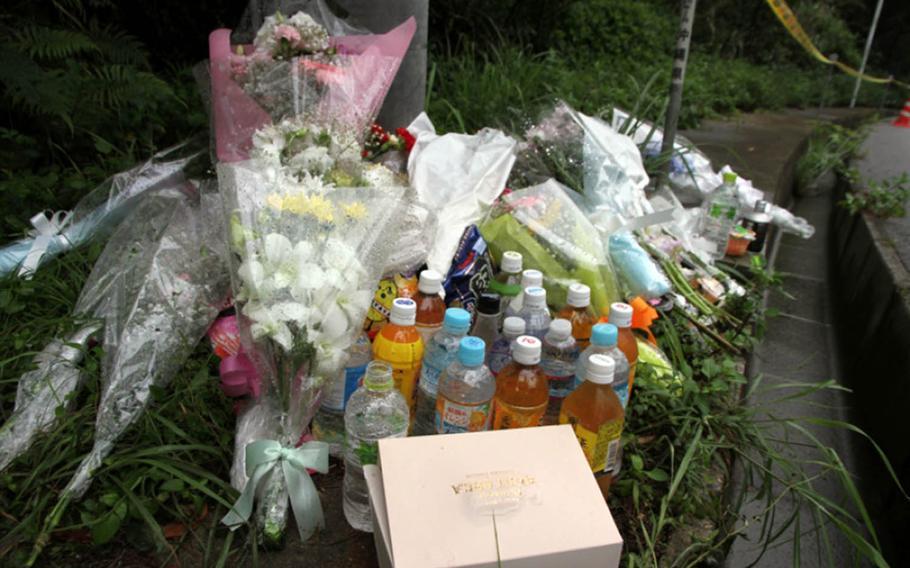 A makeshift shrine sprung up near the site where 20-year-old Uruma office worker Rina Shimabukuro's body was found on Okinawa in 2016.
