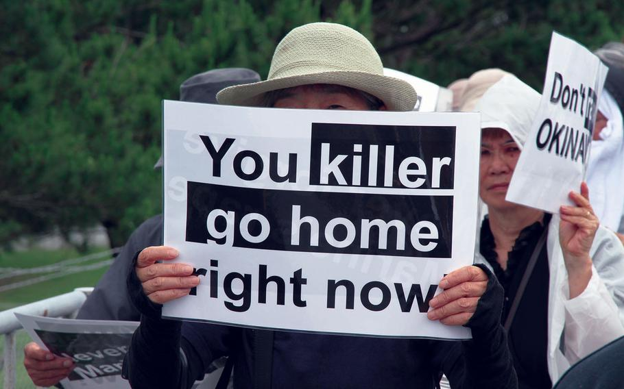 Approximately 2,000 protesters rallied in front of the gate at Marine Corps headquarters at Camp Foster last year to protest the U.S. military presence in Okinawa after a former U.S. Marine who worked as a civilian on Kadena Air Base confessed to the brutal slaying of a 20-year-old woman.