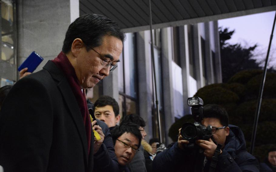 South Korean Unification Minister Cho Myoung-gyo prepares to leave Seoul for the Demilitarized Zone, where he will lead a five-member government delegation in rare talks with the North Koreans, Tuesday, Jan. 9, 2018.