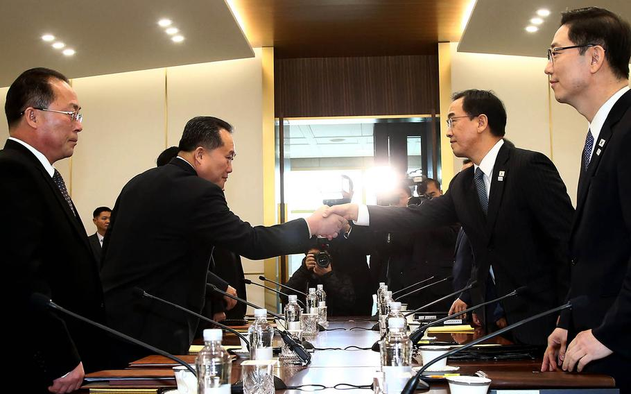 North Korea's chief delegate Ri Son Gwon, left, greets South Korean Unification Minister Cho Myoung-gyon during the first high-level talks between the two countries in more than two years, Tuesday, Jan. 9, 2017. The meeting took place in the truce village of Panmunjom in the heavily fortified border area.