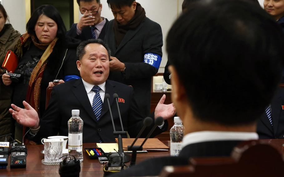 North Korea's chief delegate, Ri Son Gwon, sits across from  South Korean Unification Minister Cho Myoung-gyon during the first high-level talks between the two countries in more than two years in the truce village of Panmunjom, Tuedsay, Jan. 9, 2018.