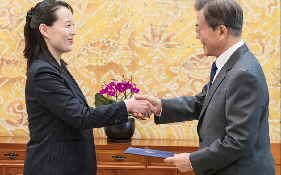 Kim Yo Jong, left, sister of North Korean leader Kim Jong Un, and South Korean President Moon Jae-in shake hands at the presidential house in Seoul, South Korea, Saturday, Feb. 10, 2018.