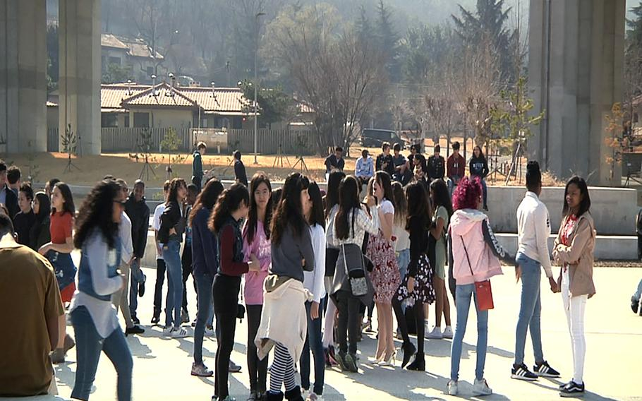 Daegu Middle High School students stage a walkout at Camp Walker, South Korea, Wednesday, March 14, 2018.
