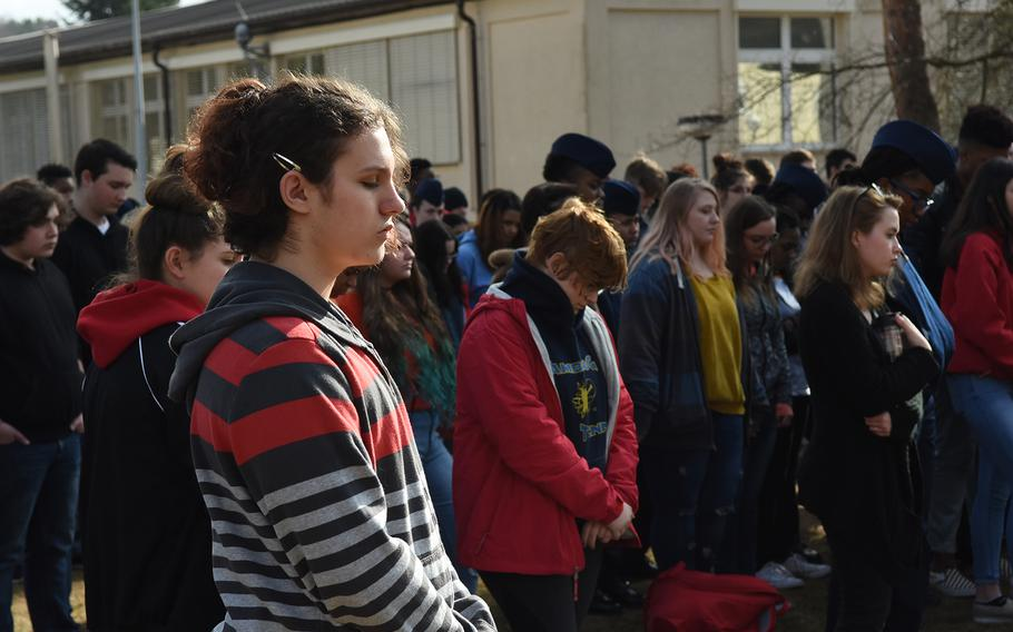 Students at Kaiserslautern High School, Germany, observe a moment of silence for each of the 17 victims of the Parkland, Fla., school shootings during a walkout Wednesday, March 14, 2018.