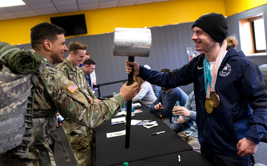 Paralympian Noah Elliott checks out a soldier's hammer at Camp Casey, South Korea, Saturday, March 17, 2018.