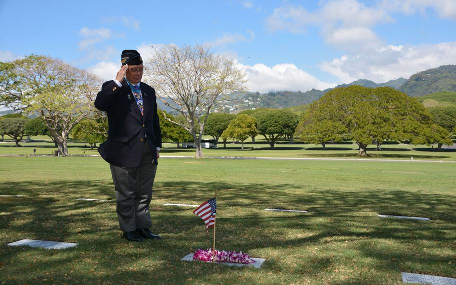 """Hershel """"Woody"""" Williams salutes before the grave of Charles G. Fischer on March 17, 2018. Fischer was a Marine Corps rifleman who died in Iwo Jima while providing covering fire for Williams. Williams learned of Fischer's identity and gravesite location only several months ago."""