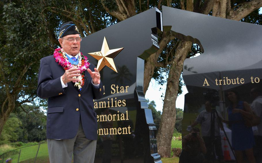 """Hershel """"Woody"""" Williams speaks in front of the Hawaii Gold Star Families Memorial Monument in Kaneohe, Hawaii, after a dedication ceremony on March 17, 2018."""
