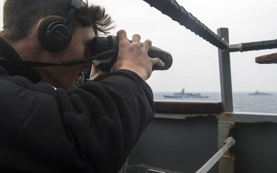 A sailor stands lookout watch on the guided-missile destroyer USS Barry during Foal Eagle drills last year off the Korean Peninsula.