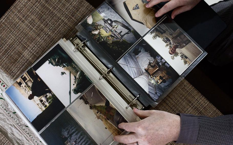 Chief Warrant Officer 3 Lindsey Muller shows old war photos from her tour to Iraq on Thursday, March 29, 2018.