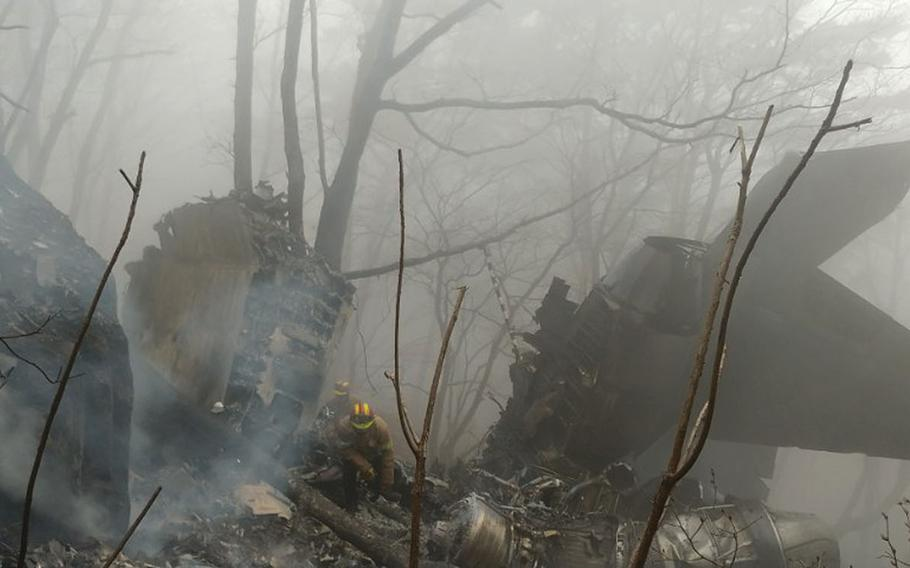 The wreckage of a crashed South Korea's air force F-15K fighter jet remain at a mountain in Chilgok, South Korea, Thursday, April 5, 2018.
