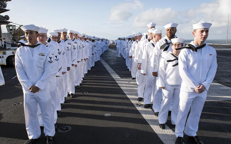 Sailors prepare to man the rails as the aircraft carrier USS Carl Vinson returns to its homeport in San Diego, Calif, Thursday, April 12, 2018.