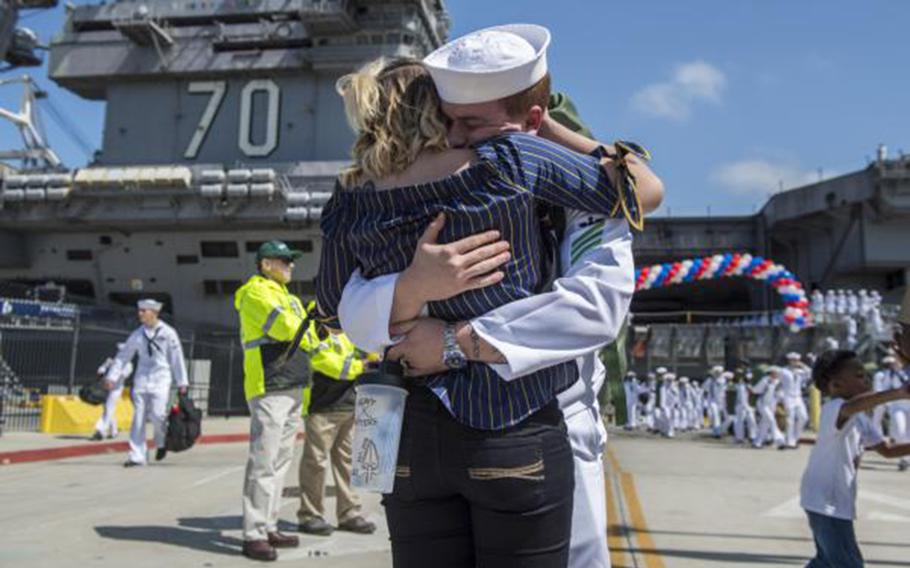Airman Dustin Thornton, from Jacksonville, Fla., assigned to Nimitz-class aircraft carrier USS Carl Vinson, reunites with his wife at the ship's homecoming ceremony in San Diego on April 12, 2018.
