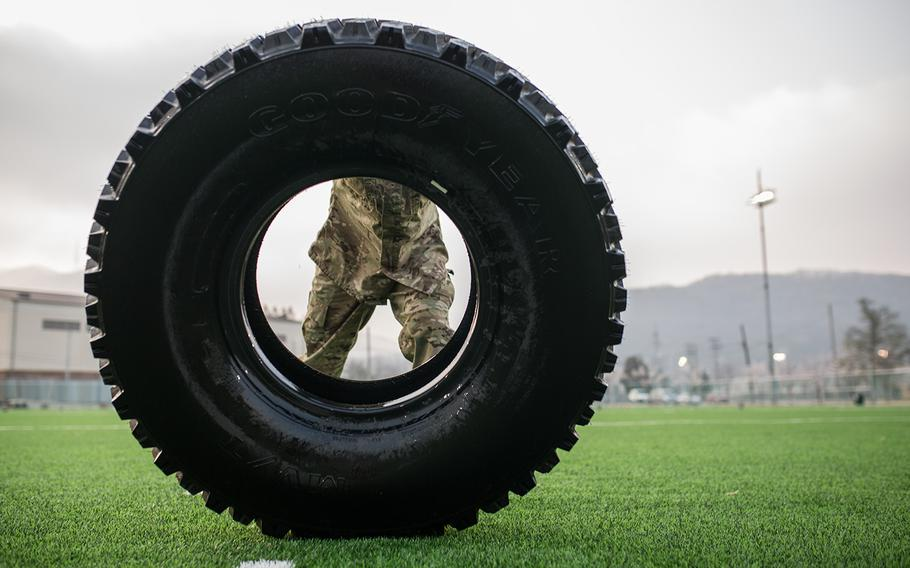A soldier pushes a tire during the 2nd Infantry Division's Best Warrior competition at Camp Casey, South Korea, Wednesday, April 11, 2018.