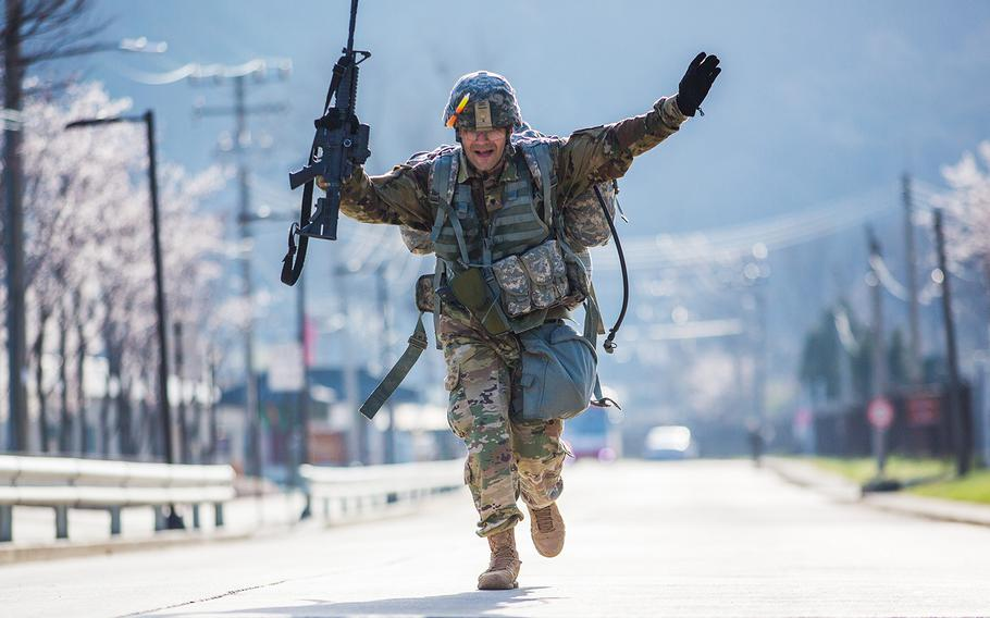 A soldier crosses the finish line at the end of a 12-mile road march during the 2nd Infantry Division's Best Warrior competition at Camp Casey, South Korea, Thursday, April 12, 2018.