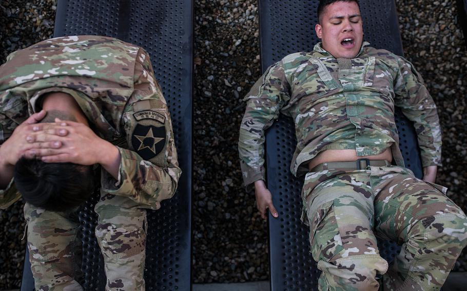 A pair of soldiers squeeze out a few more sit-ups during the 2nd Infantry Division's Best Warrior competition at Camp Casey, South Korea, Wednesday, April 11, 2018.
