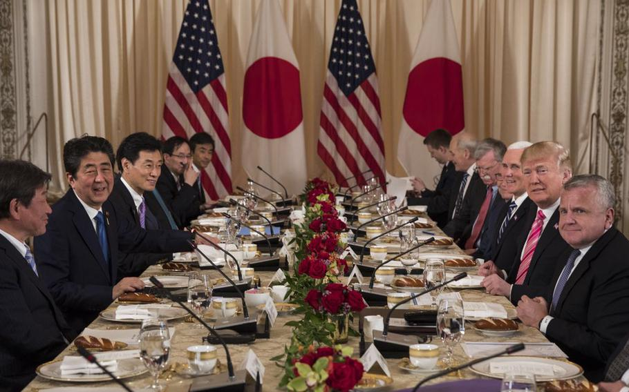 President Donald Trump, right, speaks to members of the media during a working lunch with Japanese Prime Minister Shinzo Abe, left, at Trump's private Mar-a-Lago club, Wednesday, April 18, 2018, in Palm Beach, Fla.