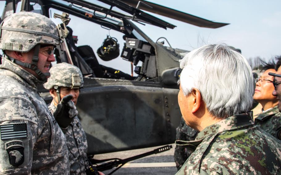 Col. Hank Taylor, the 2nd Combat Aviation Brigade commander, left, speaks with South Korean Lt. Gen. Kim, center, during the Key Resolve exercise March 11, 2015, in South Korea.