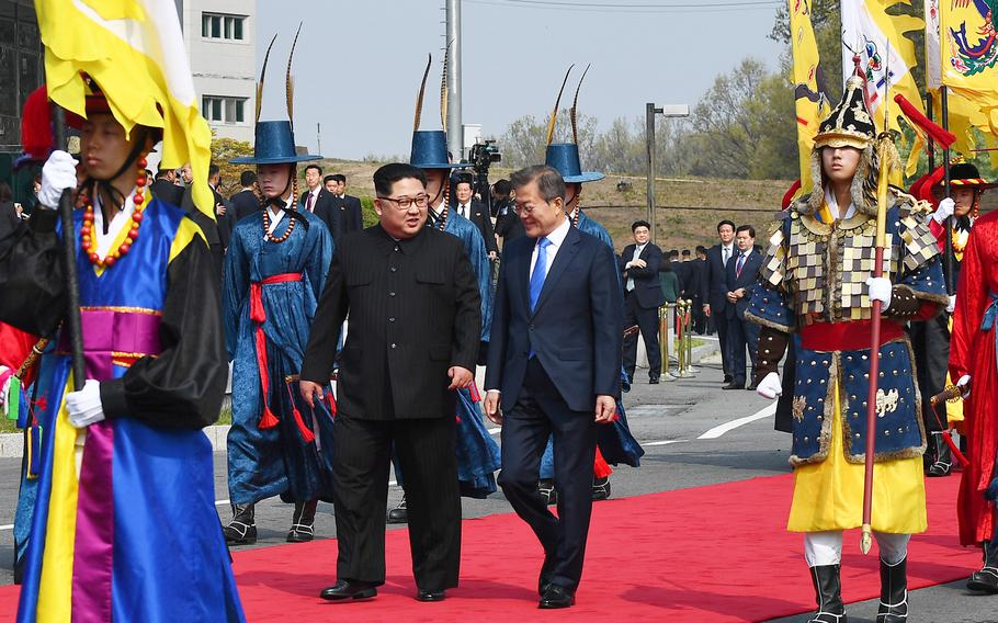 North Korean leader Kim Jong Un walks alongside South Korean President Moon Jae-in Friday, April 27, 2018 as the two leaders began a historic summit aimed at ridding the communist state of its nuclear weapons.