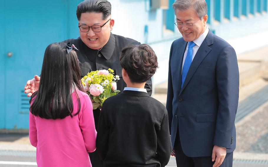 North Korean leader Kim Jong Un shakes hands with South Korean President Moon Jae-in greet two fifth-grade students from the Taesong-dong Elementary School, the only South Korean school within the DMZ Friday, April 27, 2018.